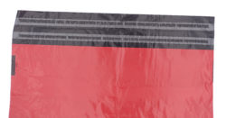 Red mailing bag - resealable strip